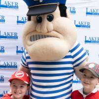 Louie the Laker poses with two young boys
